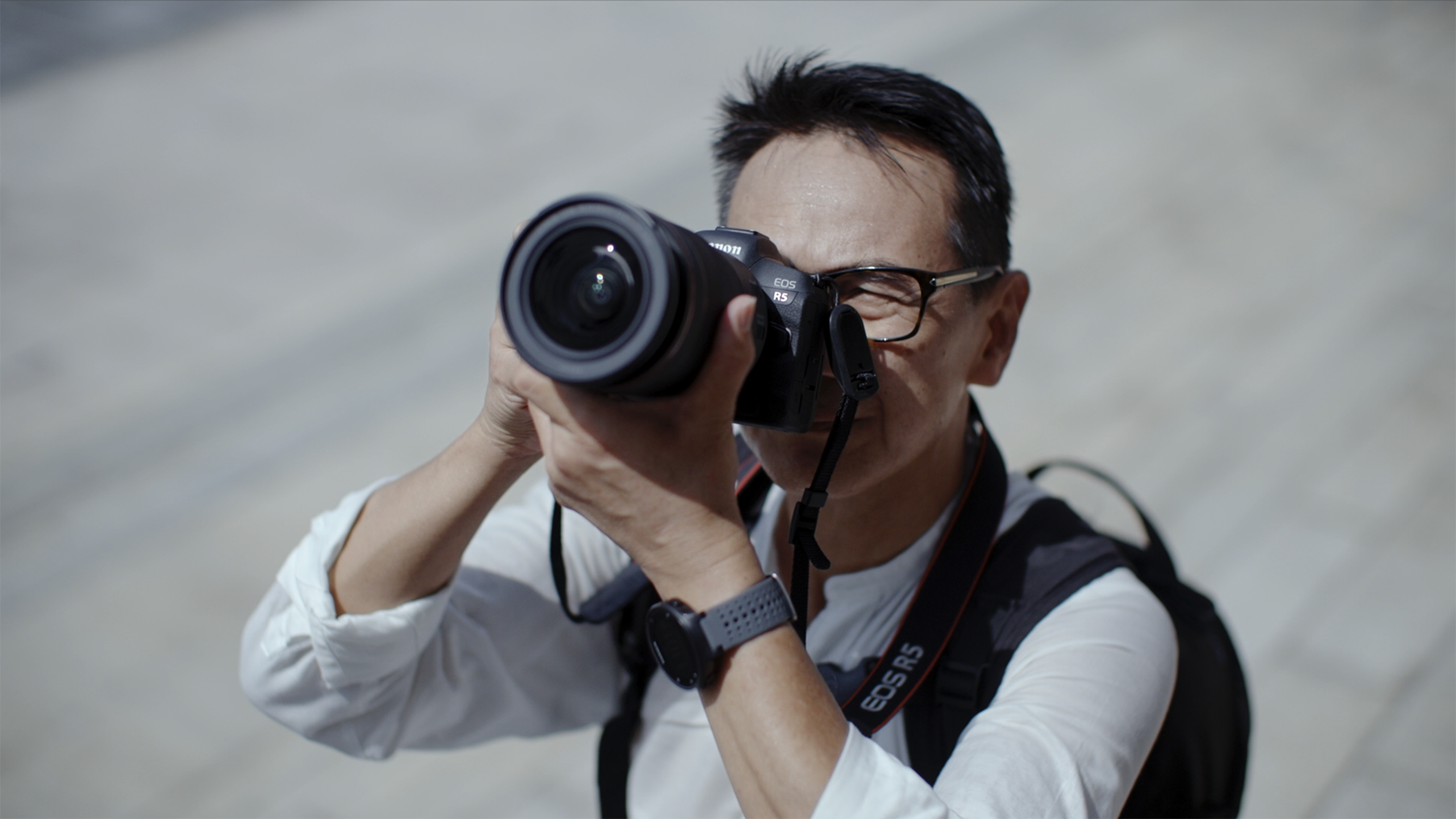 Architectural Photographer Jeffrey Wong shooting through the Canon EOS R5's viewfinder]