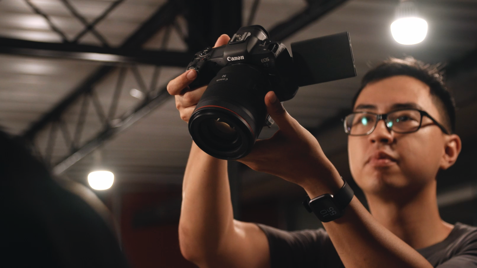Hybrid shooter Yeo Kai Wen with his eye to Canon EOS R5's viewfinder