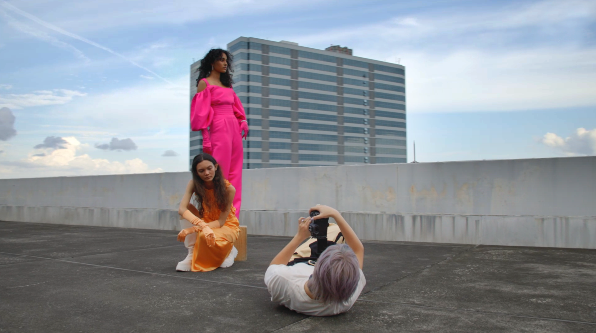Fashion Photographer Lenne Chai capturing a shot of the models against the sky for a unique perspective
