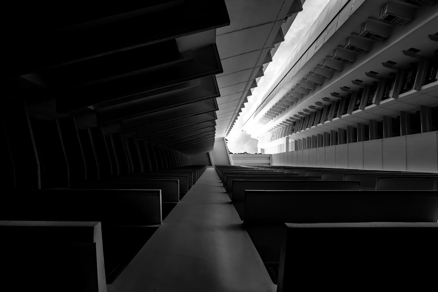 Black & White Fine Art Photography displaying the angles of a buildings as a tunnel